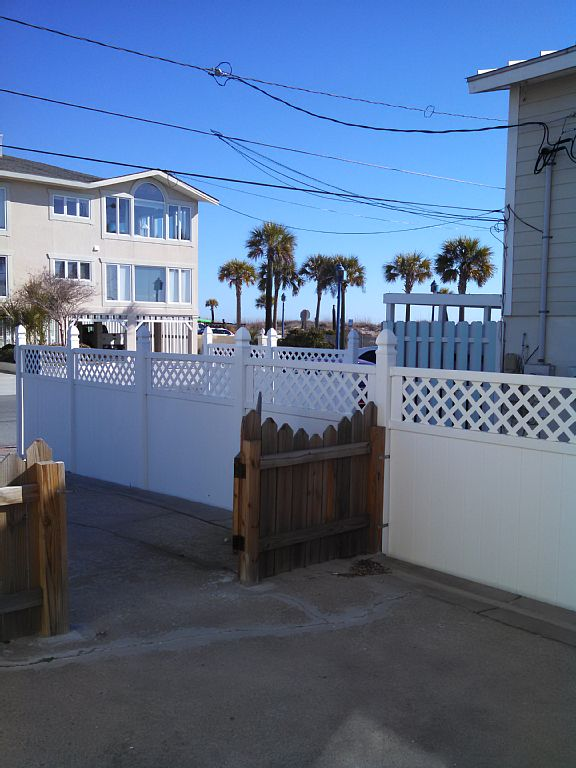 Step out of your gate, turn right and you are on the board walkway to the beach!