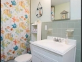 Spacious Bathroom with all the comforts of home, accessible from both bedrooms.