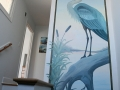 So unique, a breathtaking hand painted mural of a beautiful Egret welcomes you.