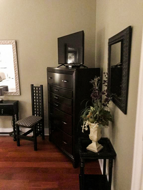 Savannah Loft bedroom showing dresser with television on top.