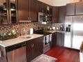 Savannah Loft kitchen sink, stove, dishwasher and refrigerator