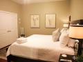 Savannah Loft bedroom showing white double doors.