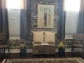 Savannah Loft living room with brick walls and decorative painting on wall.