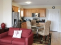 Living room and kitchen  at Silver Belles Condo located on Tybee Island