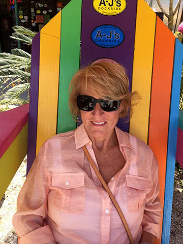 Tybee Seaside Rental's owner, Paula sitting in a beach chair